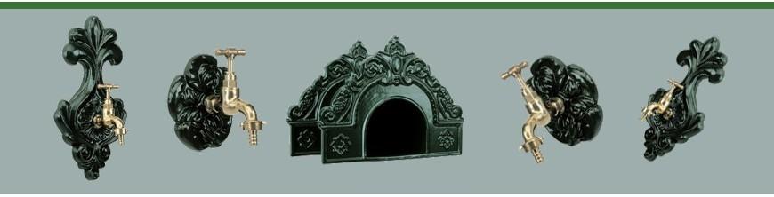 Robinets muraux d'extérieurs et porte tuyaux en fonte d'aluminium.